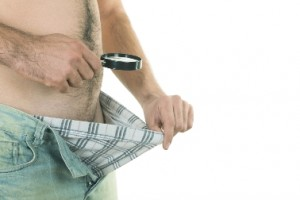 A man examines the contents of his underpants